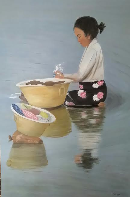 burmese-woman-washing-clothes-in-a-river