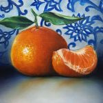 Mandarin orange on blue and white wall