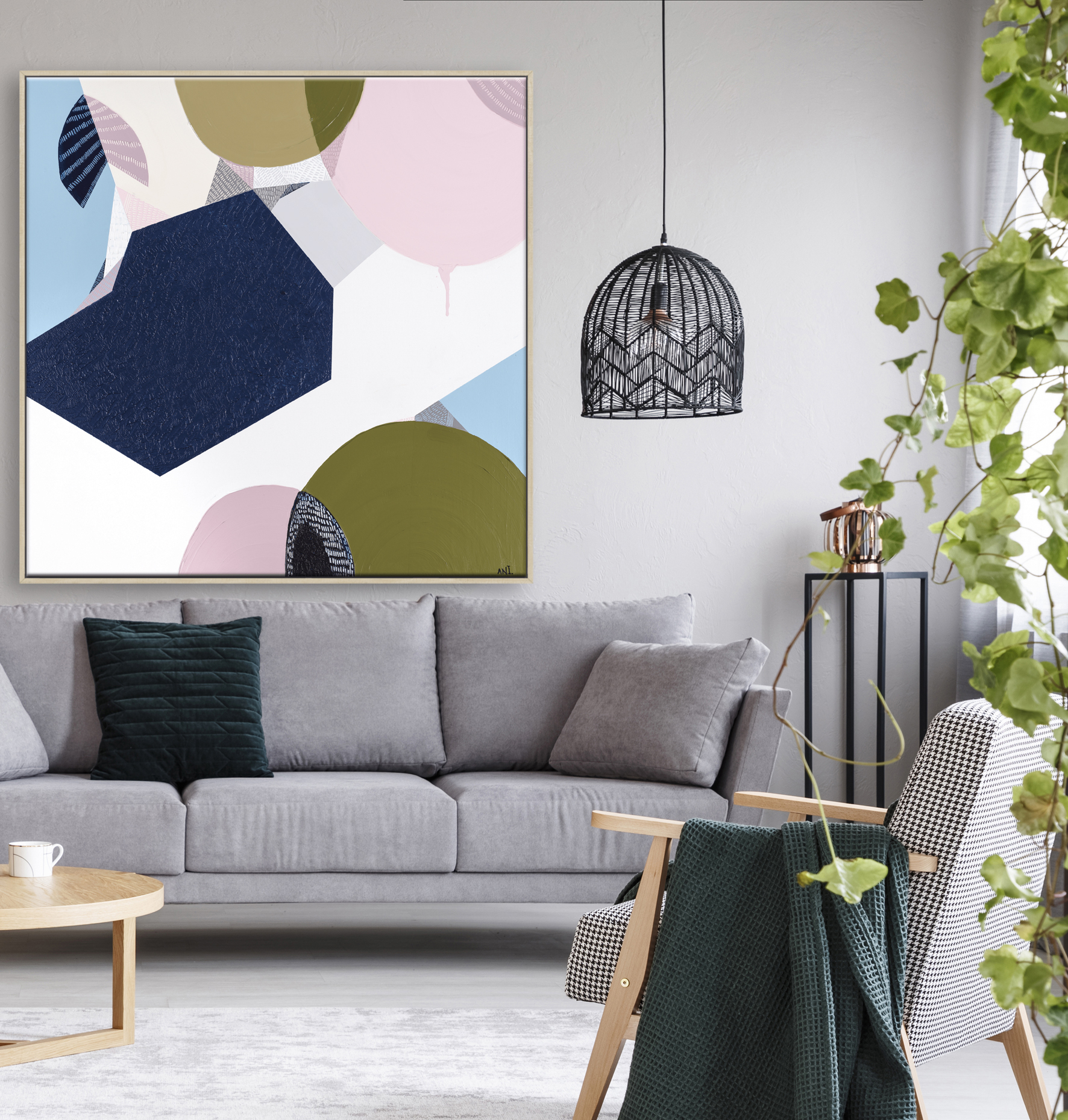 Pink Poster Above Grey Sofa In Living Room Interior With Wooden