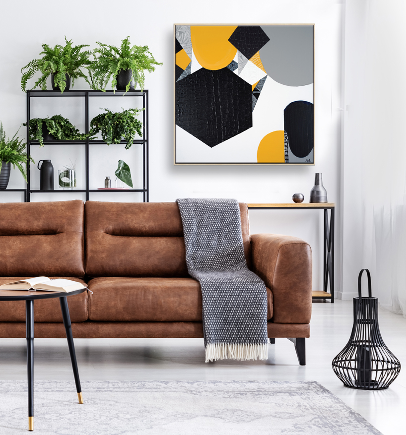 Blanket On Brown Leather Settee In Living Room Interior With Pos