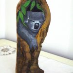 Australian Koala in gum tree, Hand-painted sculpture on camphor laurel