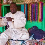 A Sudanese Shopkeeper selling handmade beaded necklaces, Omdurman Market, Khartoum, Sudan – Ltd Ed Print