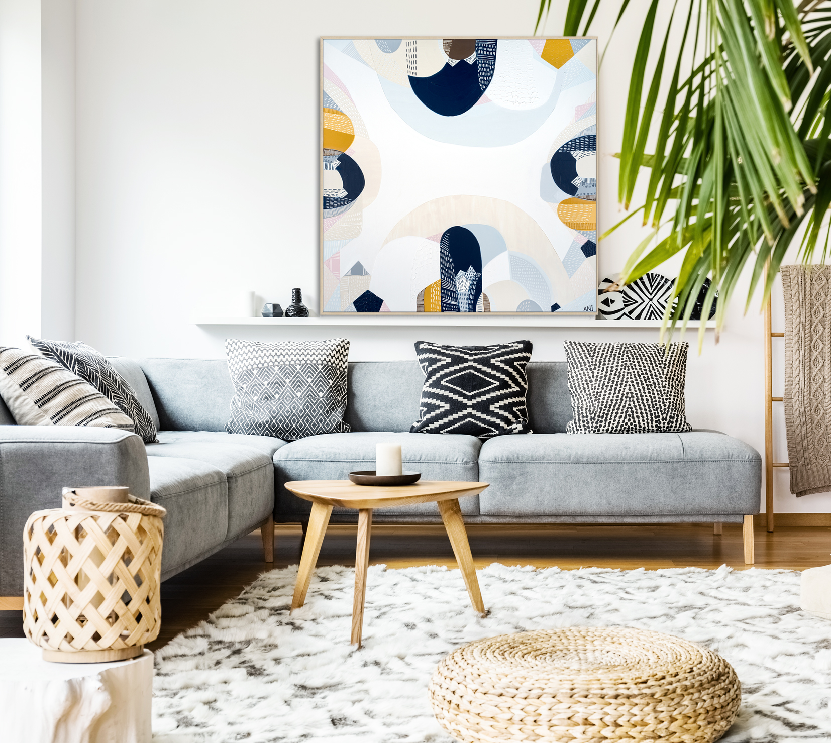 Pouf And Wooden Table In Modern Living Room With Painting Above