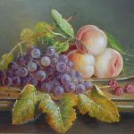 Grapes and peaches on pewter plate