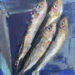 Sardines on a blue plate